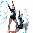 Flexible gymnasts dancing with blue ribbons — Stock Photo #5181011