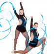 Stock Photo: Flexible gymnasts dancing with blue ribbons