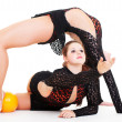 Two gymnasts posing with yellow ball — Stock Photo #5181036