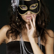 Woman hiding behind the mask - Stock Photo