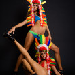 Go-go dancers in variegated feathers — Stock Photo