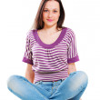 Pretty young woman sitting on the floor — Stock Photo