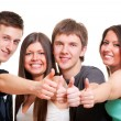 Cheerful company showing thumbs up — Stock Photo