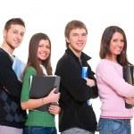 Four smiley students — Stock Photo