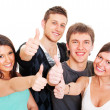 Smiley young showing thumbs up - Stockfoto
