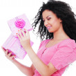 Young happy woman with a gift — Stock Photo #5181779