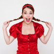 Funny happy girl with two pigtails — Stock Photo