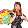 Happy young woman holding shopping bags - Foto Stock