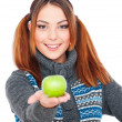 Pretty smiley woman holding green apple — Stock Photo