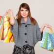 Pretty smiley woman with shopping bags — Stock Photo #5181971