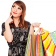 Smiley pensive woman with shopping bags — Stock Photo #5182002