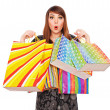 Surprised woman with shopping bags — Foto de Stock