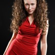 Attractive devil in red dress — Stock Photo