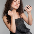 Stock Photo: Attractive woman with morror and brush