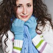 Smiley young woman in blue muffler - Stock Photo