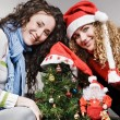 Happy girls with christmas tree — Stock Photo