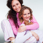 Smiley girls in pajamas — Stock Photo