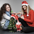 Two friends sitting near christmas tree - Foto de Stock