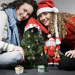 Stock Photo: Two smiley girls celebrating christmas