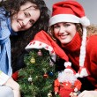 Stock Photo: Women sitting near christmas tree