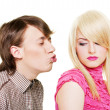 Young man want to kiss inaccessible blonde - Stock Photo