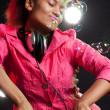 Cool dj behind the mixer - Stock Photo