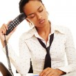 Stock Photo: Fatigued womwith telephone