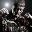 Royalty-Free Stock Photo: Expressive military man assaulting