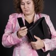 Sad businesswoman reading sms — Stockfoto