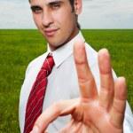Businessman showing ok — Stock Photo
