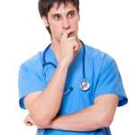 Pensive doctor in blue uniform — Stock Photo