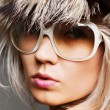 Glamor woman in sunglasses and fur hat — Stock Photo