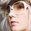 Young beautiful blond in fur hat and sunglasses — Foto de Stock