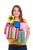 Joyful woman with gifts — Stockfoto