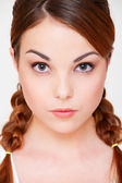 Serious woman with two braids — Stock Photo