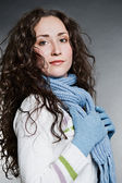 Beautiful woman in knitted gloves and scarf — Stock Photo