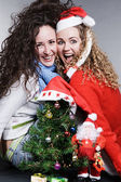 Crazy friends celebrating christmas — Stock Photo