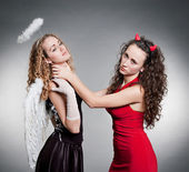 Indifferent devil want strangle angel — Stock Photo