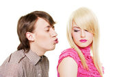 Young man want to kiss inaccessible blonde — Stock Photo
