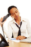 Fatigued woman with telephone — Stock Photo