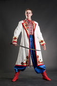 Armed young cossack in national ukrainian dress — Stock Photo