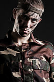 Portrait of young serious soldier — Stock Photo