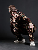 Young soldier sitting on the floor — Stock Photo