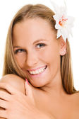 Pleasant woman with white flower — Stock Photo