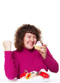 Fat woman eating pastry with pleasure — Stock Photo
