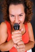 Housewife singing at karaoke — Stock Photo