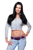 Cute young woman in blue jeans — Stock Photo