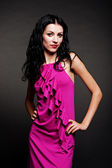 Alluring model in pink dress — Stock Photo