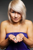 Beautiful blond holding small heart on her palm — Stock Photo