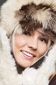 Blond with blue eyes in furs — Stock Photo
